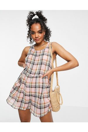 ASOS ASOS DESIGN petite smock sleeveless textured playsuit with pockets in multi check