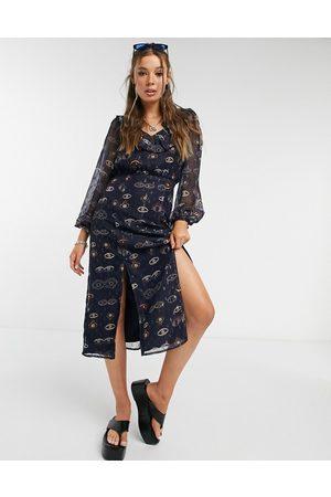 Never Fully Dressed Midi tea dress with ruffle collar in navy eye print