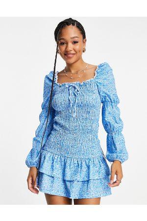 ASOS Damen Bedruckte Kleider - ASOS DESIGN Maternity shirred mini dress with long sleeves in blue ditsy floral