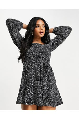 NA-KD X Pamela recycled spot print mini dress in black