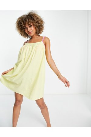 ASOS DESIGN Seersucker bow back beach mini dress in yellow