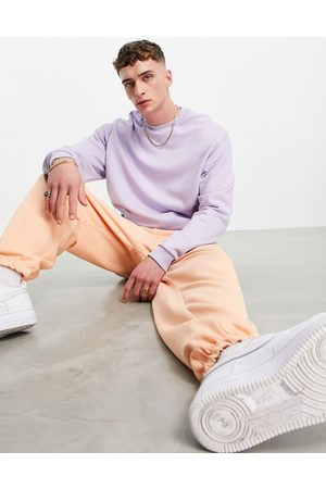 ASOS DESIGN Tracksuit with oversized hoodie and super oversized joggers in purple/orange-Multi