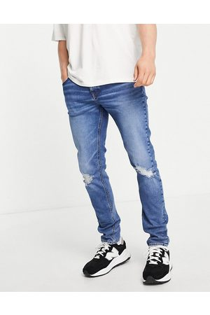 ASOS Organic cotton blend skinny jeans in dark wash blue with knee rips
