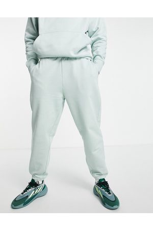 ASOS Herren Lange Hosen - Co-ord heavyweight oversized joggers in washed green