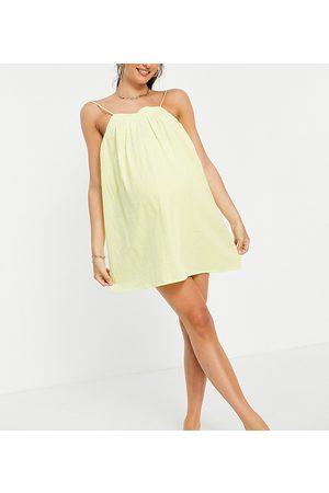 ASOS ASOS DESIGN maternity seersucker bow back mini beach dress in yellow