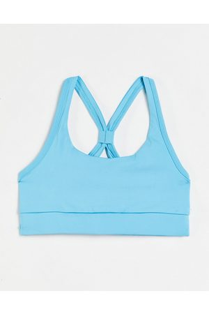 Love & Other Things Gym co-ord open back sports bra in blue