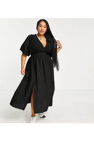River Island Damen Freizeitkleider - Puff sleeve midi dress in black