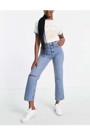 ASOS DESIGN High rise stretch 'slim' straight leg jeans in midwash with rips-Blue