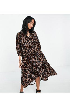 ASOS Petite ASOS DESIGN Petite midi shirt smock dress with tiering and puff sleeve in black base zebra