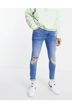 ASOS DESIGN Spray on jeans with power stretch in 'less thirsty' vintage light wash-Blue