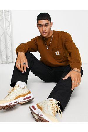 Carhartt Pocket oversize sweatshirt in brown