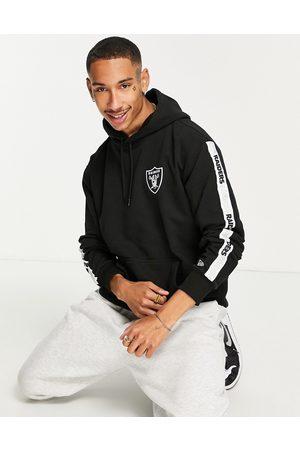 New Era Herren Sweatshirts - Las Vegas Raiders taping hoodie in black