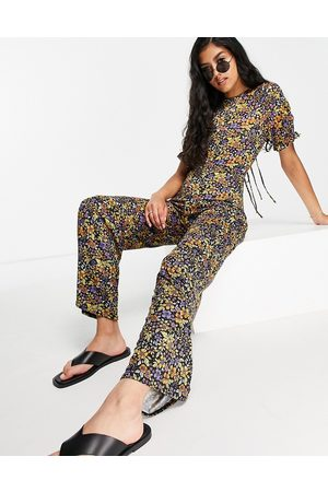 ASOS Tie back puff sleeve flare leg jumpsuit in lilac floral-Multi