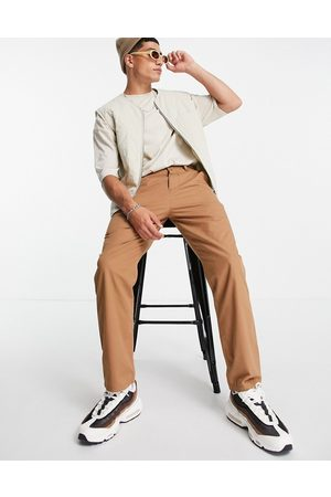 ASOS DESIGN Lightweight skater fit trousers in brown