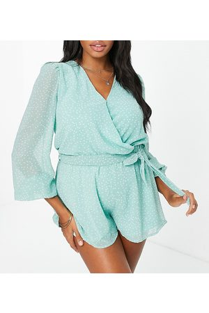 In The Style Maternity X Dani Dyer wrap detail floaty playsuit in green polka print