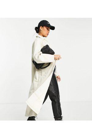 ASOS Petite ASOS DESIGN Petite 90s faux leather trench coat in cream-White