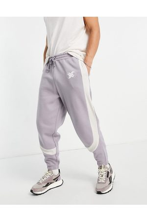 ASOS DESIGN Oversized joggers in grey colour block with rib details-Purple