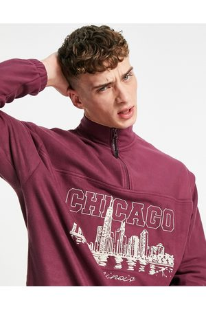 ASOS Oversized half zip in fleece with Chicago chest embroidery-Red