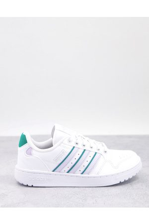 adidas NY 90 trainers in white with blue stripes