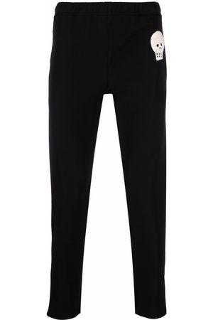 Alexander McQueen Herren Jogginghosen - Skull-patch slim-fit track pants