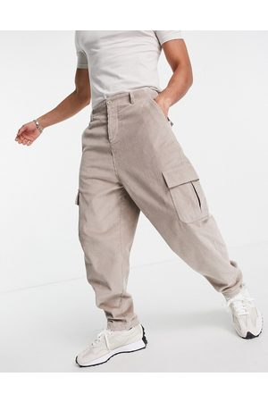 ASOS Oversized tapered fit trousers with cargo pockets in cord-Neutral