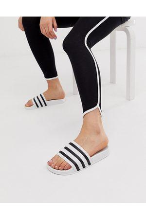 adidas Originals Adilette sliders in white and black