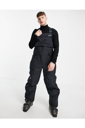 Planks Yet hunter shell ski bib trousers in black