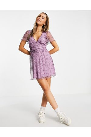 ASOS DESIGN Mesh ruched front mini dress in purple floral