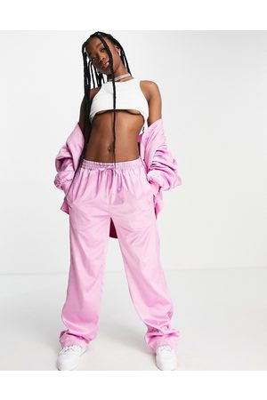 adidas Originals 2000s Luxe' satin wide leg trousers in pink with diamante logo