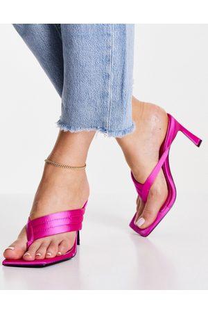 ASOS DESIGN Herring padded toe thong heeled sandals in pink