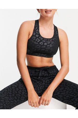Nike Nike Pro Training tonal leopard print medium support sports bra in black