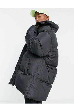 ASOS Oversized longline puffer jacket in black