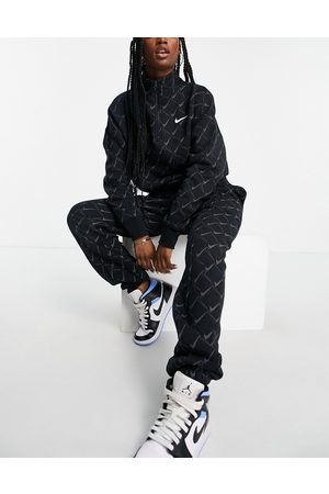Nike Oversized joggers in black with all over swoosh print