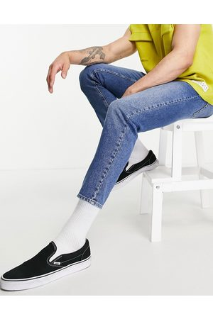ASOS Classic rigid jeans in vintage mid wash blue containing hemp