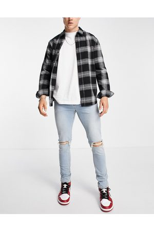 ASOS Skinny jeans in tinted light wash with knee rips-Blue