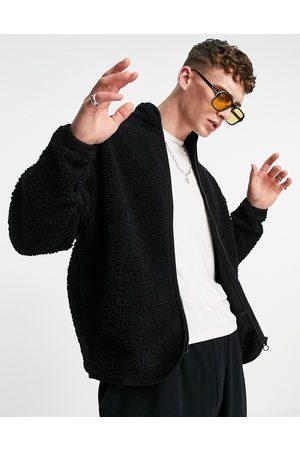 ASOS Oversized track top in black teddy borg