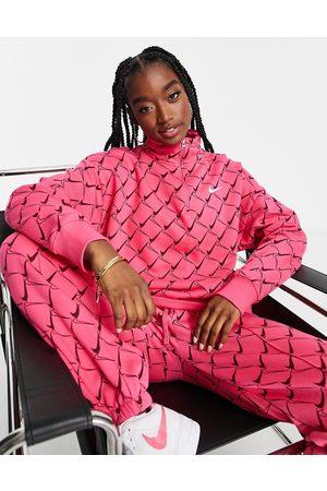 Nike Zip neck sweatshirt in watermelon pink with all over swoosh print