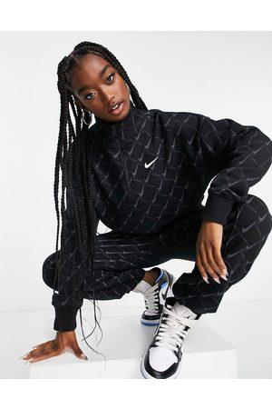 Nike Zip neck sweatshirt in black with all over swoosh print