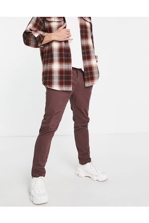 ASOS Skinny chinos with elasticated waist in brown