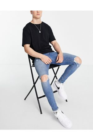 ASOS Spray on jeans with power stretch in vintage mid wash with knee rips-Blue