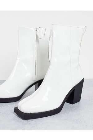ASOS Heeled chelsea boots in white patent leather with black sole