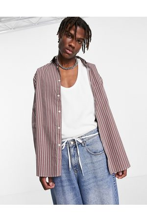 ASOS Oversized shirt with stepped hem in brown stripe