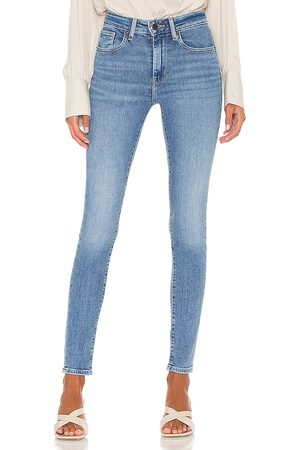 Levi's 721 High Rise Skinny Jean in - Blue. Size 23 (also in 24, 25, 26, 27, 28, 29, 30, 32).