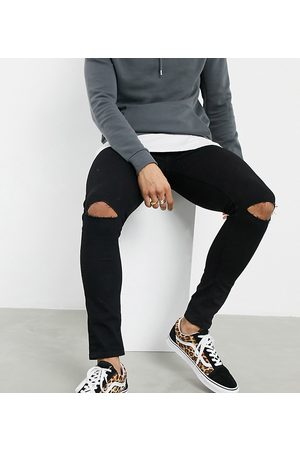 ASOS Spray on jeans in power stretch denim with knee rips in black