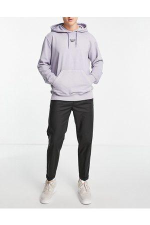 New Look Herren Chinos - Tapered pleated smart trousers in dark grey