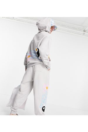 ASOS ASOS Daysocial co-ord oversized jogger with multi placement logo and graphic prints in stone-Neutral