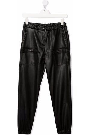 Msgm Leder & Lederimitathosen - TEEN faux-leather tapered trousers