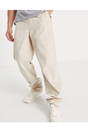 ASOS Relaxed trousers in check cord design-Neutral