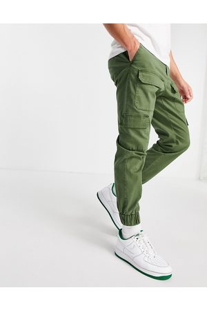 ASOS Tapered trousers with multi pockets in khaki-Green