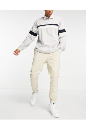 ASOS Tapered chino joggers with elasticated waist in -Neutral